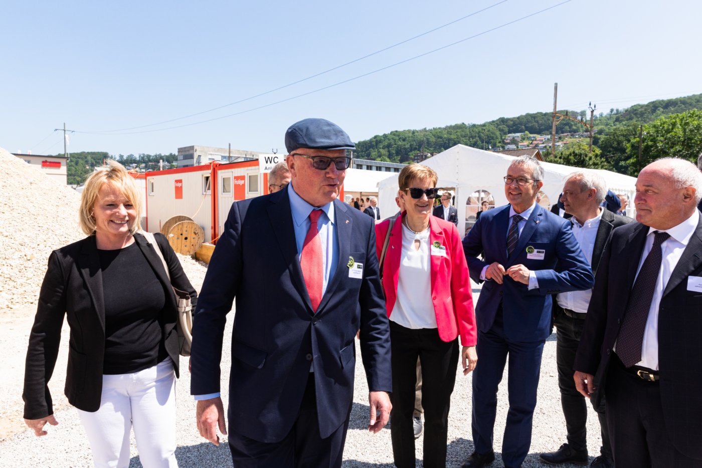 Photos for this media folder, The invited guests on their way to the construction site for the official laying of the foundation stone (from left to right): Elisabeth Schneider-Schneiter, Dr Thomas Staehelin, Dr Sabine Pegoraro, Thomas Weber, Daniel Bürgin and Karl Gun. © Copyright Sara Barth, Basel  Digitale Medienmappe «Laying the uptownBasel foundation stone: a quantum leap for the industry», uptownBasel